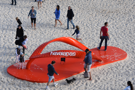 Sydney, Australia - Oct 23, 2016 Big Red Havaianas thongs on Tamarama beach. Sculpture by the Sea is one of the Largest free to the public sculpture Exhibitions. Editorial