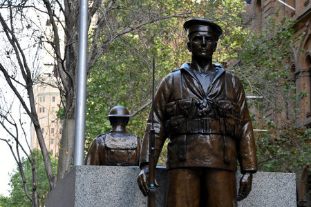 symbol victim: Sydney, Australia - Oct 16, 2016 Two bronze statues, a sailor and a soldier guarding the Cenotaph. It is one of the Oldest World War I monuments at Martin Place, Sydney, Australia. Editorial