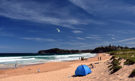 nsw: Sydney, Australia - Nov 6, 2016 People relaxing at the beach on the first hot day in the season. Mona Vale, Sydney, NSW, Australia.