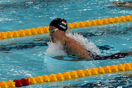 Hong Kong, China - Oct 29, 2016. Hungarian swimmer Zsuzsanna Jakabos swimming breaststroke. FINA Swimming World Cup, Preliminary Heats, Victoria Park Swimming Pool.