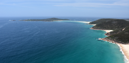 nsw: Shark Island and coastline of Shoal bay on a sunny day from Mount Tomaree Lookout (Central Coast, NSW, Australia) Stock Photo