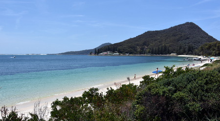 surfers paradise: Shoal bay on a sunny day, Mount Tomaree in the background (Central Coast, NSW, Australia)