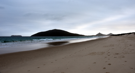 nsw: Hawks Nest beach at sunset. Mount Yakaba in the background (Central Coast, NSW, Australia)