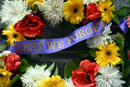 Colorful fresh floral wreaths for Anzac Day memorial celebrations to honor and remember those who gave their lives in battles lest we forget.
