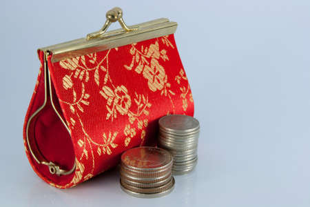 Beautiful purse with  coins isolated on white background photo
