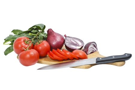 Chopped tomatoes and onions on a chopping board with a knife - isolated on white Stock Photo