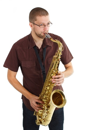 Portriat of a man with glasses, wearing brown shirt, playing the saxophone - isolated on white