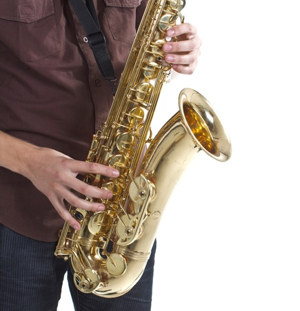 Close-up of a man wearing brown shirt is playing the saxophone, only the instrument, hands and part of the mans body are shown - isolated on white