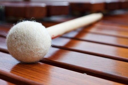 Close-up of a mallet on a wooden marimba