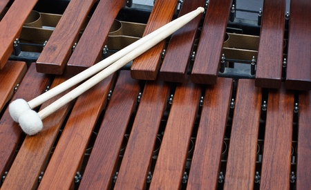 Close-up of a pair of mallets on a wooden marimba