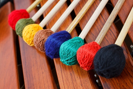 Close-up of coloured mallets on a wooden marimba photo