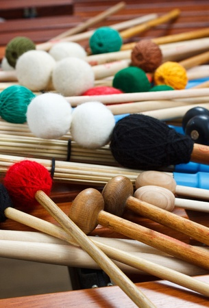 A pile of coloured mallets and a pair of unplugged drum sticks Stock Photo
