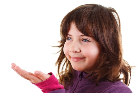A beautiful 9-year-old girl with brown hair smiling, showing her empty palm - isolated on white