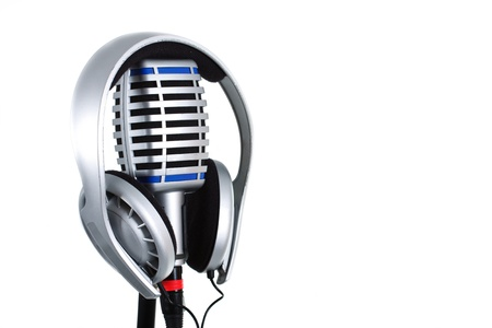 A headset on a microphone isolated on white