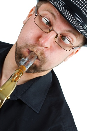Close-up of young man making funny grimace squinting while playing the saxophone - isolated on white photo