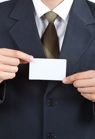 Close-up of a blank card held by a businessman with suit and tie