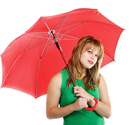 An attractive young blond woman in green top, holding a red umbrella, smiling into camera - isolated on white Stock Photo