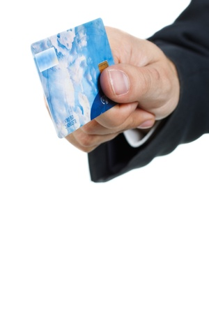 Close-up of businessman`s hand showing a credit card - isolated on white
