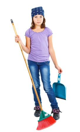 Full-body portrait of a 9-year-old girl in jeans and purple top, blue scarf on head, holding a dustpan and a broom - isolated on white