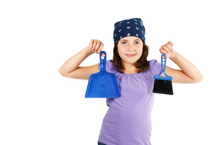 Portrait of a cute 9-year-old smiling girl holding a blue dustpan and broom - isolated on white