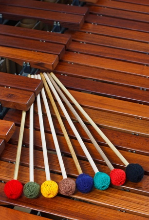 Coloured marimba mallets resting on a marimba Stock Photo