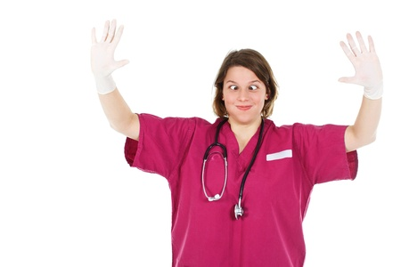 A young female doctor hands up in gloves, making faces, stethoscope round her neck - isolated on white Stock Photo