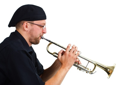 Portrait of a young man wearing black shirt and cap, playing the trumpet - isolated on white Stock Photo