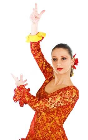 Portrait of a woman flamenco dancer wearing orange and yellow dress - isolated on white Stock Photo