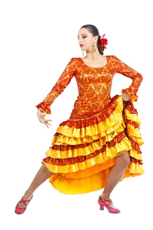 Full-body portrait of a woman flamenco dancer wearing orange and yellow dress, looking down - isolated on white Stock Photo