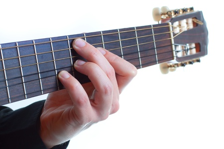 Close-up of a mans fingers playing the guitar - isolated on white