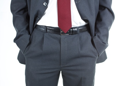 Close-up of a businessmans hands in his pocket, wearing suit and tie - isolated on white
