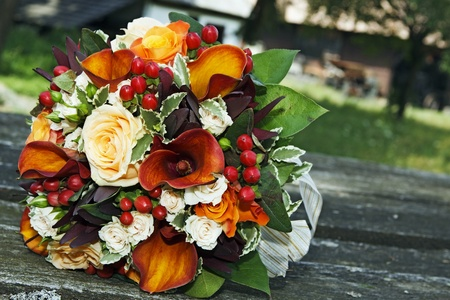 Close-up of a colourful wedding bouquet outdoors