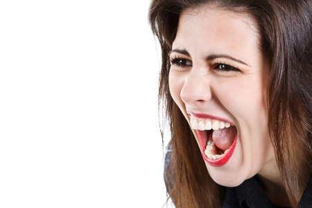Close-up of a beautiful young woman with long brown hair, red lips, screaming in anger - isolated on white Stock Photo