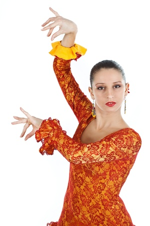 Portrait of a woman flamenco dancer wearing orange and yellow dress, looking into camera - isolated on white