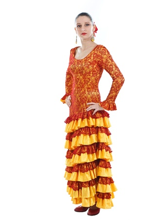 Full-body portrait of a woman flamenco dancer wearing orange and yellow dress, looking into camera - isolated on white