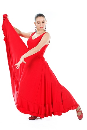 Full-body portrait of a woman flamenco dancer wearing red dress, looking down - isolated on white Stock Photo - 12304699