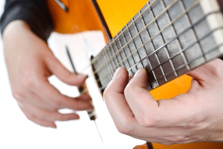 Close-up of a man's hands playing the guitar - isolated on white Stock Photo - 12304621