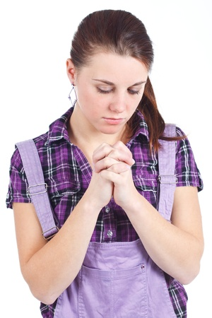 pony tail: Portrait of young attractive woman with long red hair, with pony tail, wearing purple checked shirt, praying, looking down - isolated on white Stock Photo