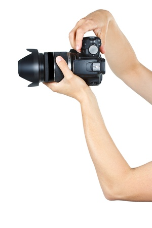 Close-up of female arms and hands holding a camera - isolated on white photo