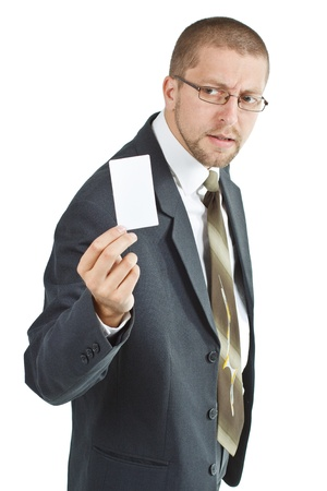 A young businessman wearing suit and tie is holding a blank card in his right hand - isolated on white photo
