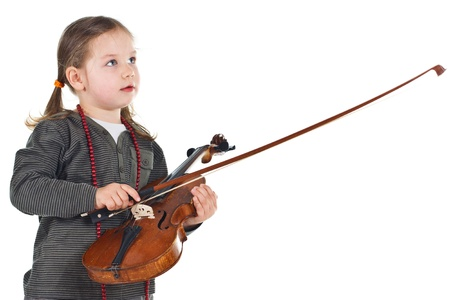 Portrait of a beautiful little girl holding a violin - isolated on white photo