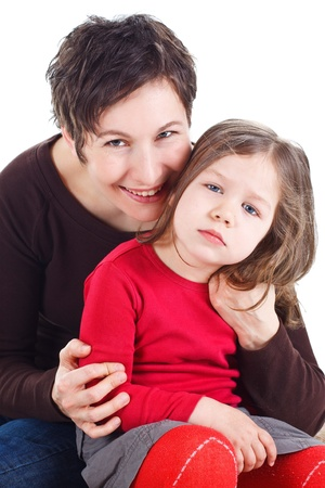 rtrait of a cute 3-year-old girl and her young mother, both looking into camera - isolated on white Stock Photo