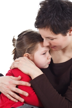 Portrait of young mother comforting her cute little 3-year-old daughter, cuddling - isolated on white Stock Photo