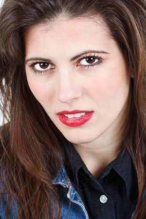 Portrait of a beautiful young woman with long brown hair, brown eyes, red lips