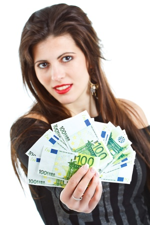 Close-up of banknotes - euros - held by a beautiful young woman with long brown hair, smiling in the background - isolated on white Stock Photo