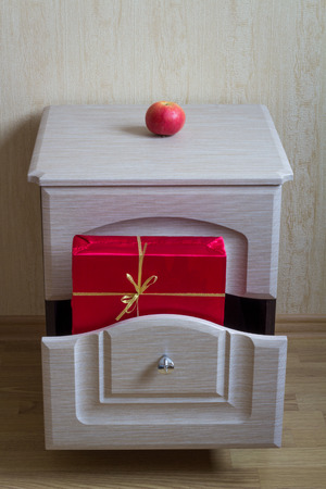 nightstand: Red Gift in the nightstand.