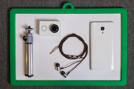 mobile headset: Action Camera, Tripod, Headset and Mobile Phone at Whiteboard