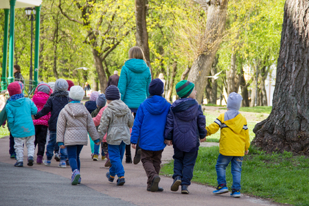 excursions: Kids at excursions, holding hands,  back view at Ukraine