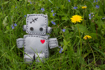 soft toy: Robot With Heart. Macro Soft Toy at nature background.