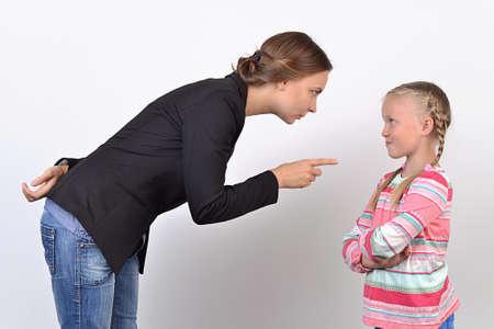 criticize: Women criticize girl, shake a finger to her